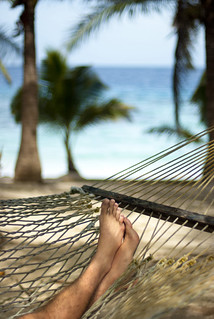 Man relaxing in a hammock | by Photo Everywhere