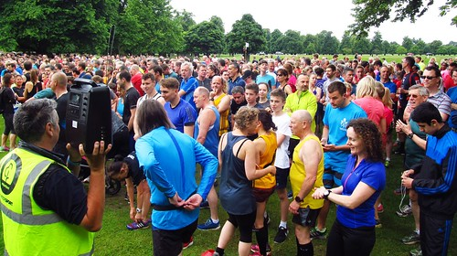 parkrunners listen to announcements at the start