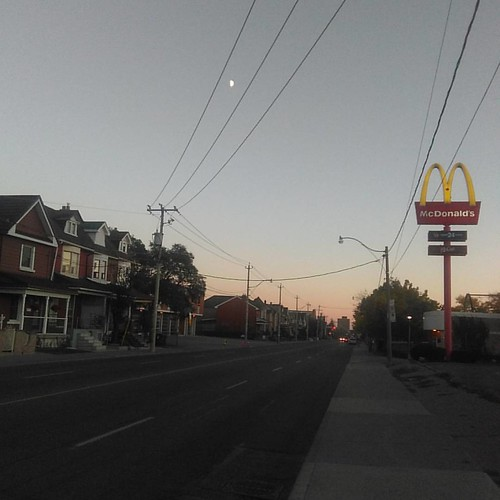 Looking south down Dufferin past the Golden Arches #toronto #evening #dufferinstreet #moon #mcdonalds
