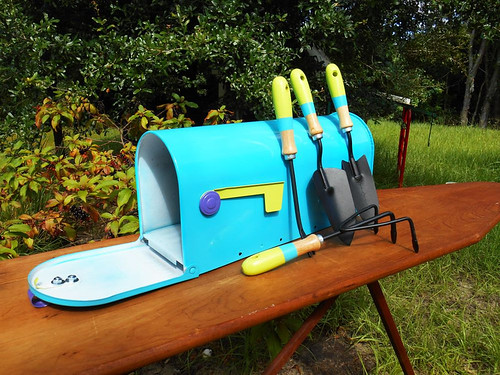 Garden tools and upcycled mailbox with painted hand garden for Gardening tools 7 letters