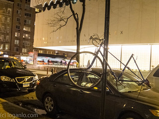 Bicycle hanging on a pole in NYC | by Logan607