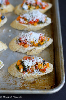 Skinny Pesto Pizza Crostini...Great for a crowd!  So easy that the kids can make these. 51 calories & 1 Weight Watcher PP | cookincanuck.com #recipe #appetizer #vegetarian | by CookinCanuck