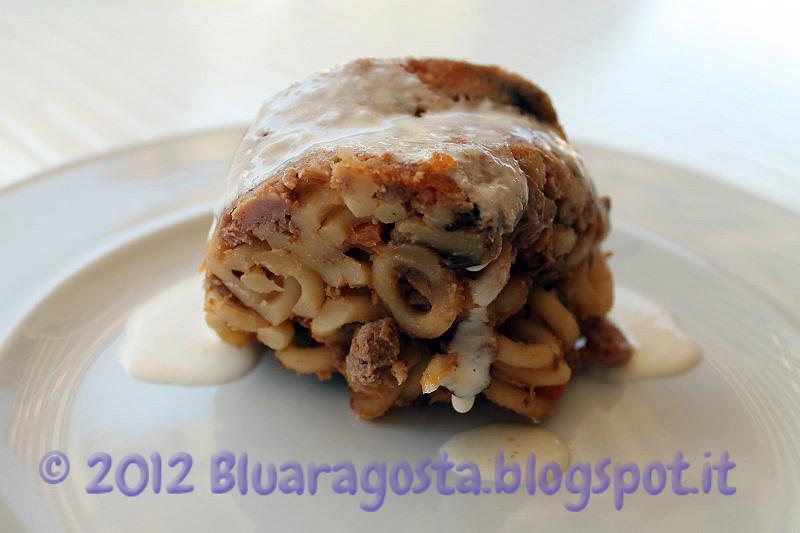 06-timballo di anelletti con fonduta al parmigiano