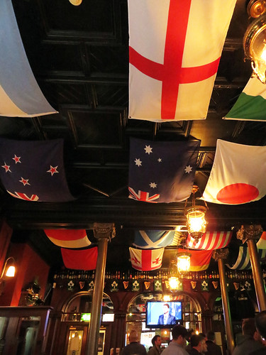 Flags of the world decorate the ceiling of The Garrick, a pub in Belfast, Ireland, UK