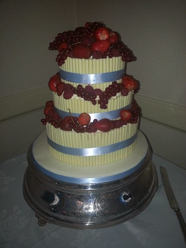 White chocolate cigarello Wedding cake with red berries | by platypus1974