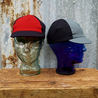 Hot off the sewing machinery, Tarik Saleh Bike Club cap Samples, TSBC logo to be added. Propellerless brimmed beanie style on clear head, and classy goblin on blue head.  Order window closes tomorrow, Friday 4/24, Tariksaleh.com/tsbc for details. | by Target Salad