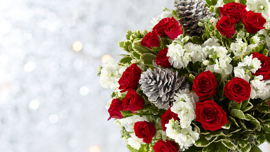 winter flower bouquet including red roses and pine cones | Flickr