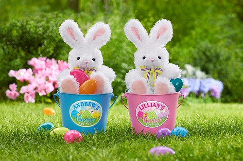 bunny rabbits with bow ties in personalized Easter bucket baskets full of colorful plastic eggs on a grass lawn and flowers | by PersonalCreations.com