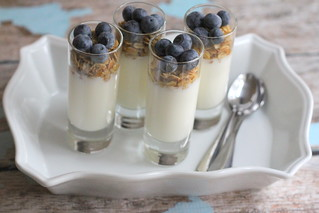 yogurt parfait with granola and blueberries in shot glasses with silverware spoons | by PersonalCreations.com