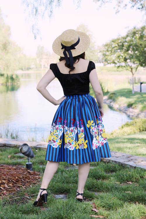 Pinup Girl Clothing Pinup Couture Jenny Skirt in Mary Blair Clown Border Print Peasant Top in Black Sateen