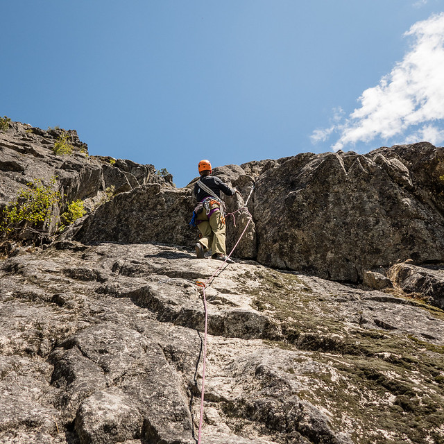 Shelley leading a trad route