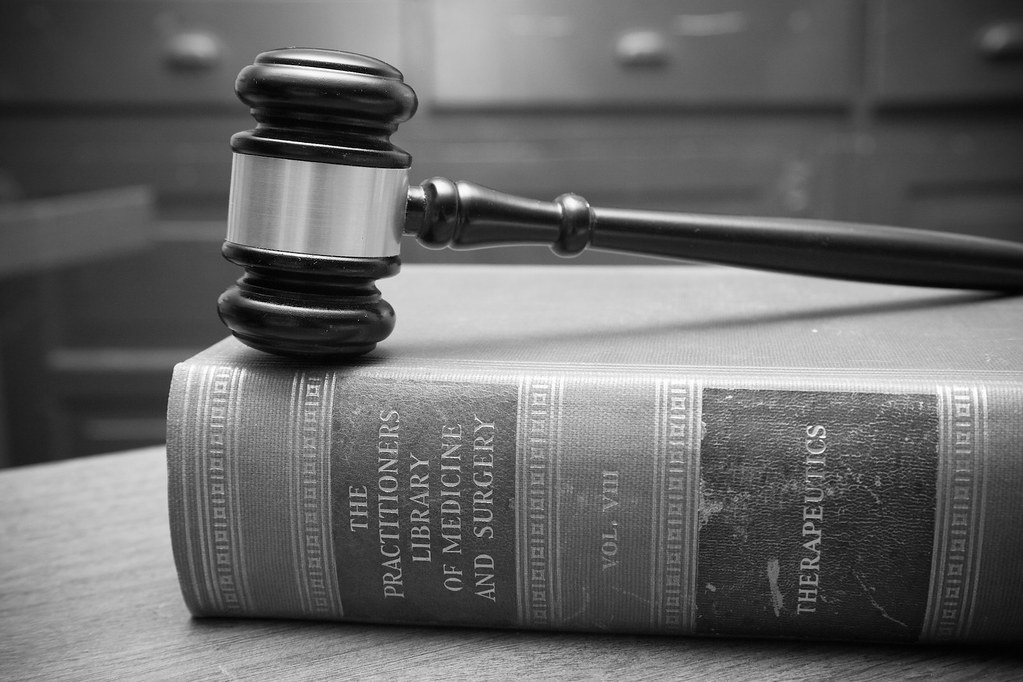 Weiss paarz photos black and white gavel in courtroom law books by weiss paarz photos