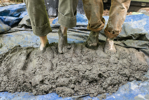 Liz & Chad Mixing Earthen Floor Mix with Feet | by goingslowly
