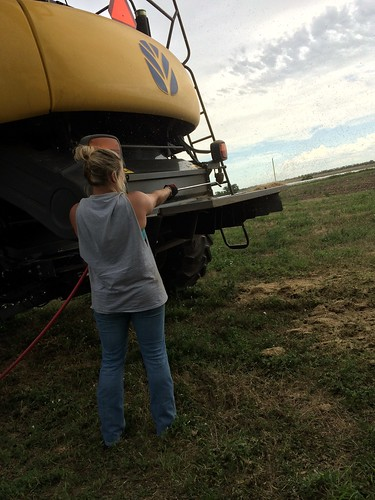 Cleaning off the combines for the trip north.