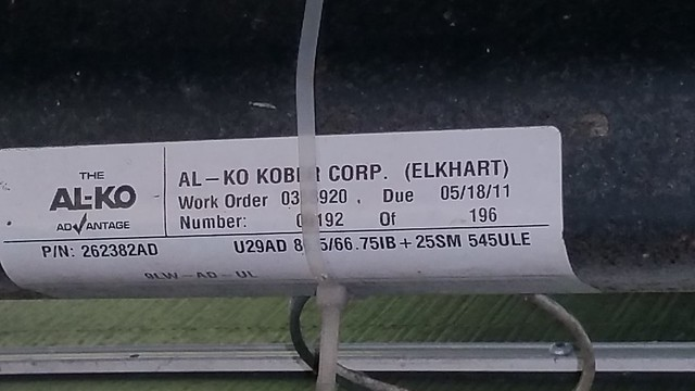 Label, rear axle. Part no. 262382AD