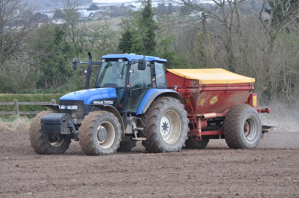 New Holland TM150 Tractor with a Bredal K85 Bulk Spreader