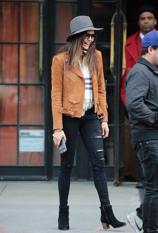 Nina Dobrev in camel suede biker jacket black distressed jeans and a large hat