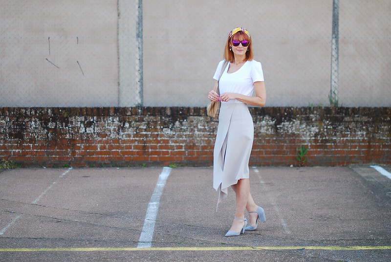 Ladylike Spring/Summer look: Plain white tee, pastel grey assymetric hem midi skirt, grey strappy heels, headscarf | Not Dressed As Lamb