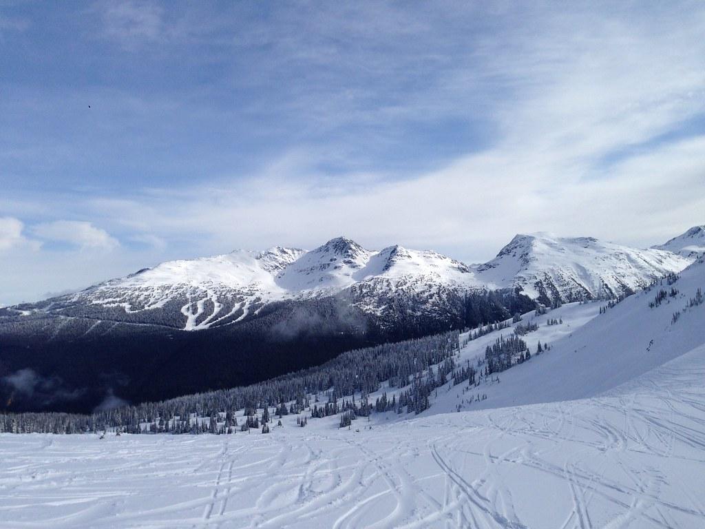 Blue sky spring snowboarding