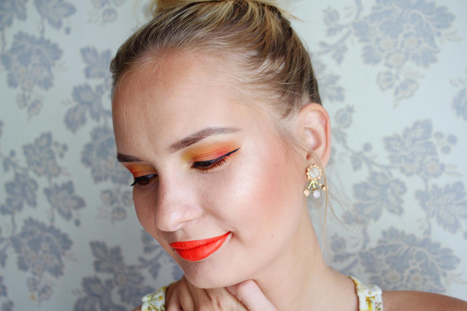 Bright orange makeup look
