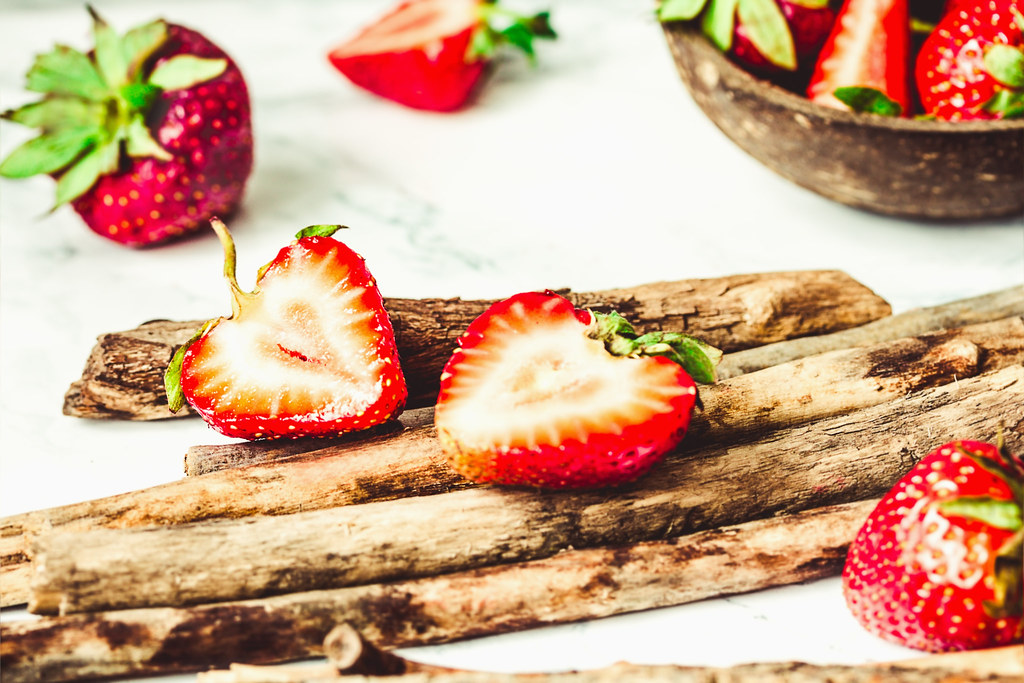 Fresh juicy strawberries in coconut shell, close-up