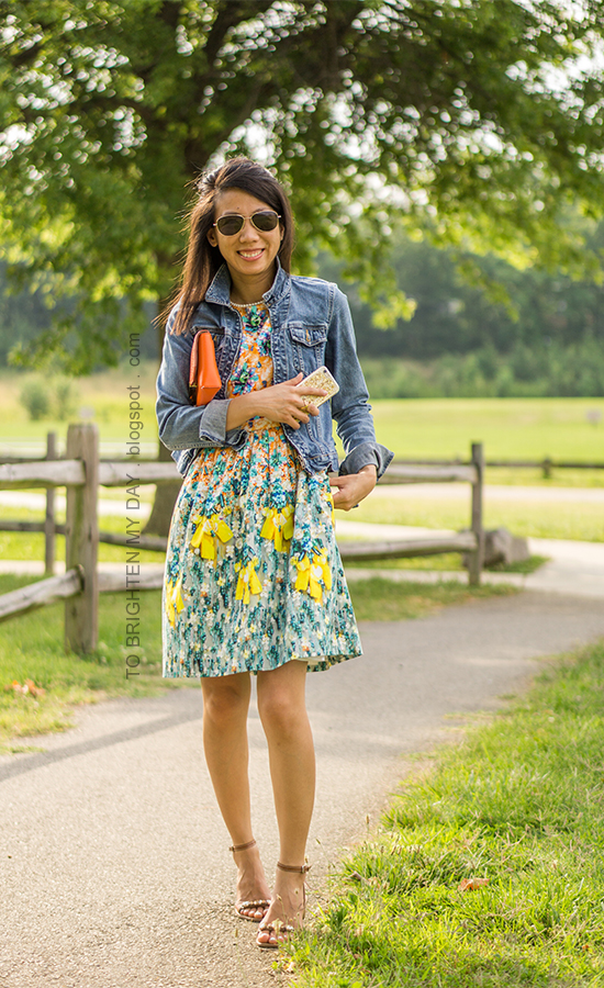 denim jacket, orange clutch, floral dress, jeweled blocked sandals
