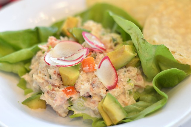 This is a picture of devon crab tostado with avocado and relish topping