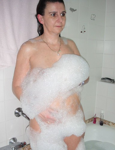 Surprised Mom in shower naked