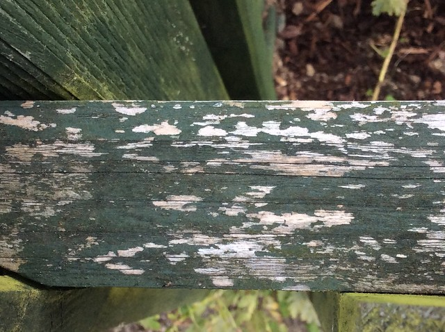 Distressed paint effect on the picket fence