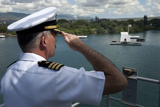The XO of USS Pearl Harbor salutes the USS Arizona Memorial as the ship passes it while entering port. | by Official U.S. Navy Imagery