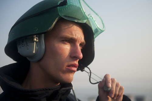 A Sailor serves as phone talker during an anchoring evolution. | by Official U.S. Navy Imagery