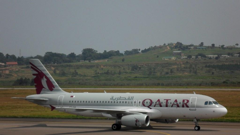 qatar airways plane arriving at entebbe airport  uganda