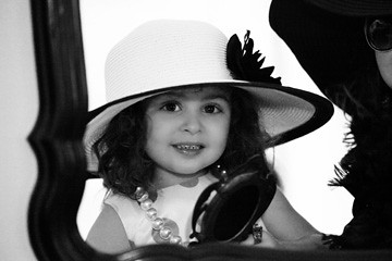 Child Playing Dress Up To Make The Coco Chanel Party