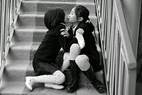 asian girl kissing white girl