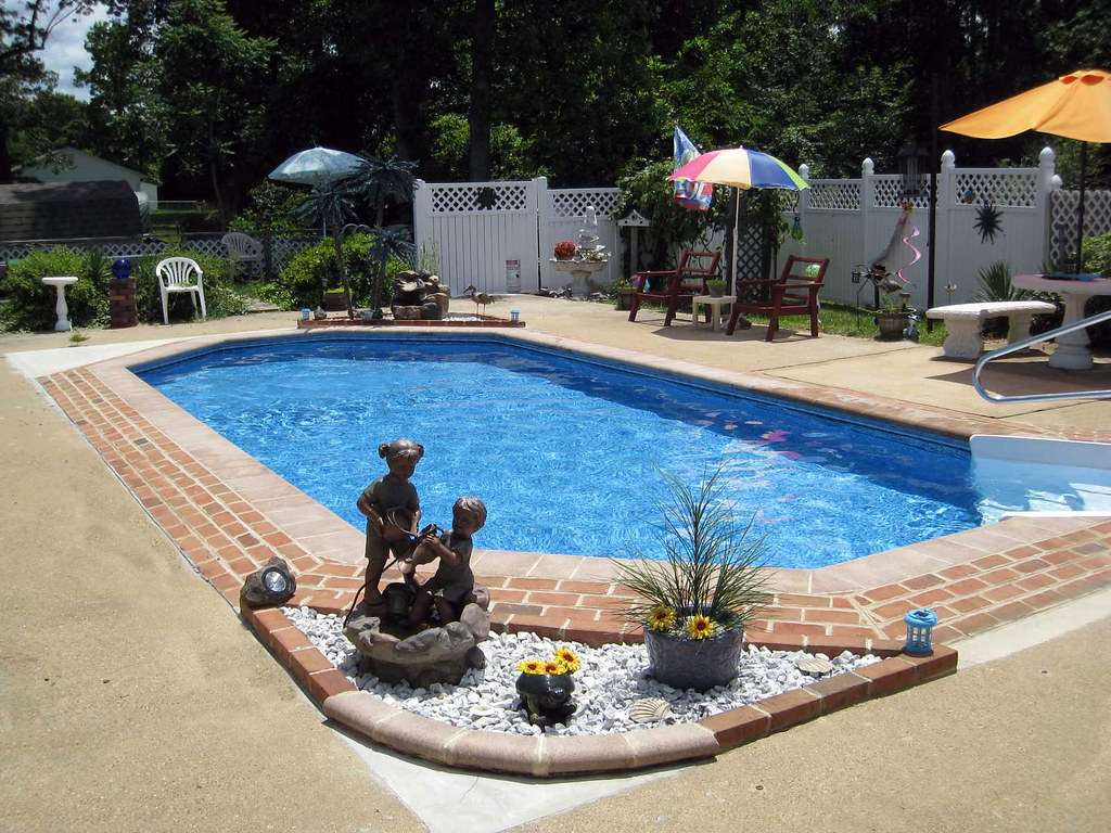 Inground swimming pool rectangle grecian brick and concret for Grecian swimming pool