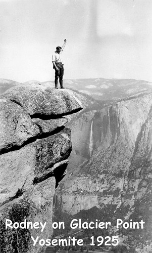"1925 - Glacier Point. My father doing something he shouldn't do. In those days there were no railings. He and a friend had just climbed up the ""Ledge Trail."" This trail has been closed for several years. 