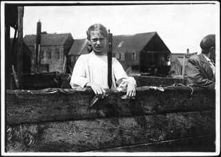 Minnie Thomas, 9 years old, showing the average size of the sardine knife as large as this. Eastport, Me, August 1911 | by The U.S. National Archives