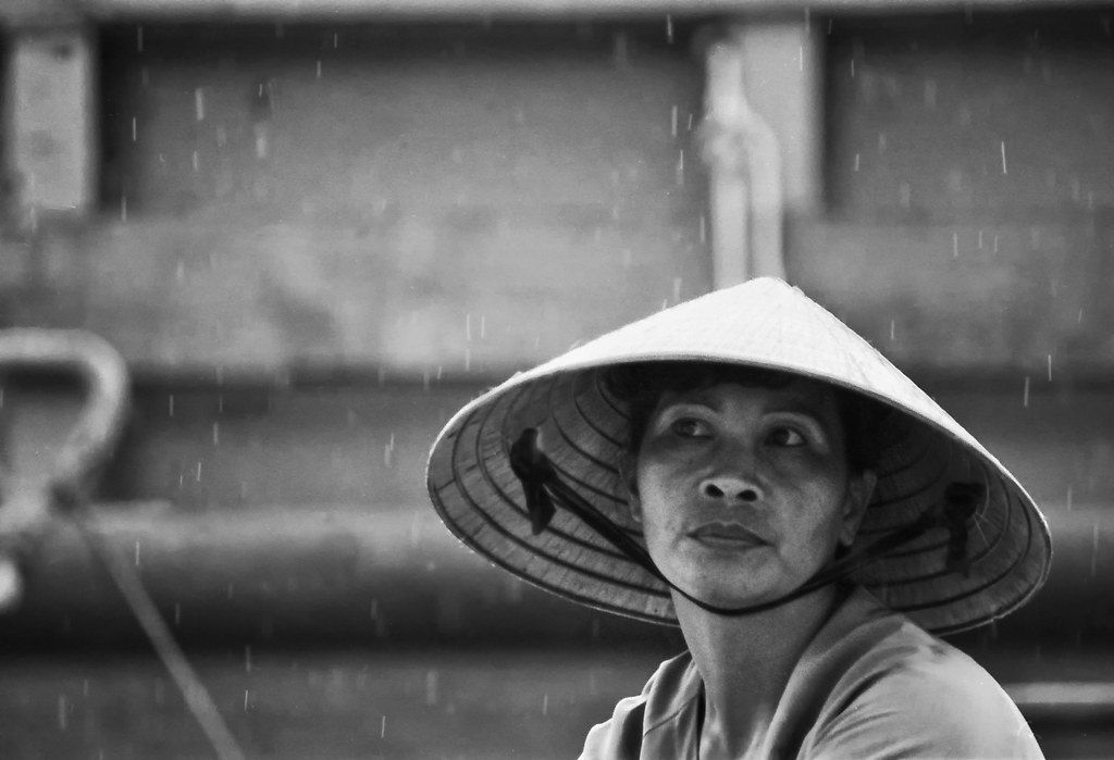 Vietnamese Lady At A Mekong Floating Market