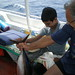 Sa'ed entertained by Nikos Bollos and freshly caught tuna, onboard the Liberty the way to Cyprus, p192