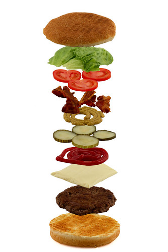 Isometric exploded view of hamburger ingredients isolated on white | by lavsen