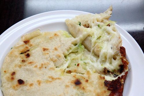 Squash-and-cheese pupusa (tearaway view), Pupusa Zone, Woodside, Queens | by Eating In Translation