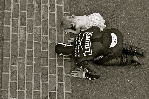 Jimmie Johnson and his daughter kissing the bricks at IMS | by indianapolismotorspeedway.com