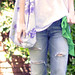 ripped jeans - white tee- scarf bow belt-floral bag