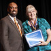 Betsy Napier, recipient of the SUNY Chancellor's Award for Excellence in Classified Service, with Dr. Quintin Bullock, President of SCCC