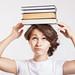 Schoolgirl with books on head