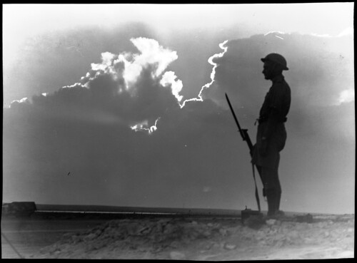 El Alamein [lone soldier on guard in silhouette] | by National Library of Australia Commons