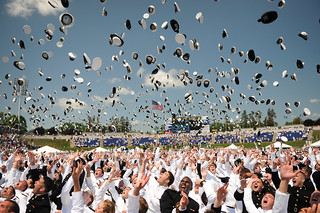 Graduates in the U.S. Naval Academy Class of 2012 toss their covers following the school's annual graduation and commissioning ceremony. | by Official U.S. Navy Imagery