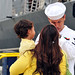 A Sailor says goodbye to his family before boarding USNS Mercy.