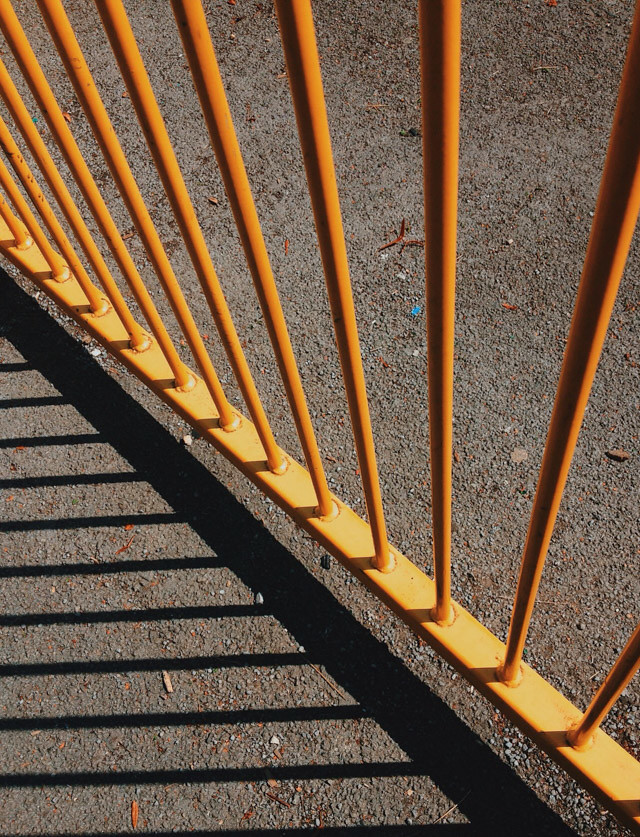 yellow gate and strong shadow