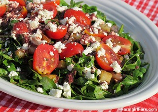 Arugula salad with pan-fried herbed potatoes, cherry tomatoes, feta cheese, and kalamata olive vinaigrette | by Farmgirl Susan